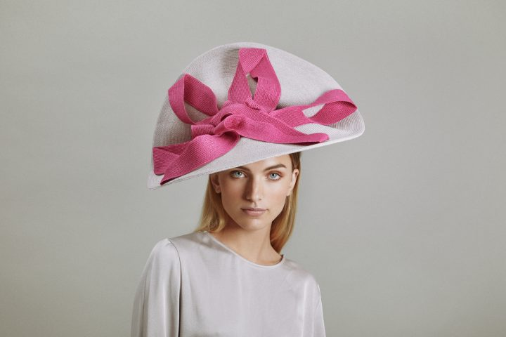 Uplifted hat in white and pink straw