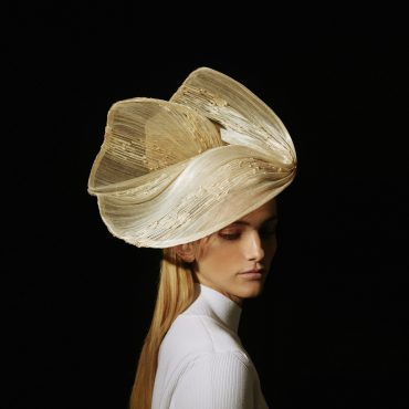 Couture hat called paradisier with soft lines in natural color